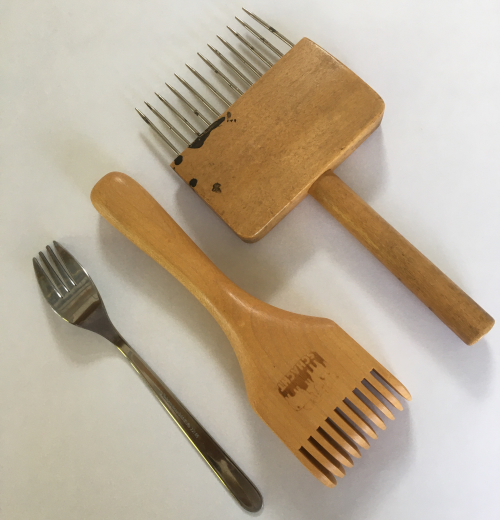 tapestry beaters and a fork